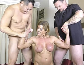 Ripped nude woman bodybuilder Lacey loves cock. The only things she loves more than a cock is two cocks! Watch Lacey give an expert blow job - full of deep throats and throat fucking - until she gets a nice gooey facial.